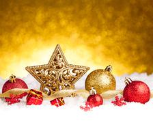 Golden christmas fir star decoration with gold and red ornaments Stock Photos