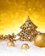 Golden christmas fir tree decoration with gold ornaments Stock Photos