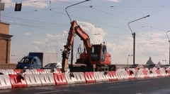 Excavator breaking road surface with hydrohammer drill at repairing roadwork Stock Footage