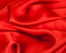 Red fabric on a white background Stock Photos