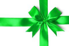 Shiny green satin ribbon on white background Stock Photos