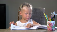 four-year girl performs educational tasks - stock footage