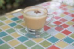 blurry defocused hot cappuccino coffee with cinnamon topping for background - stock photo