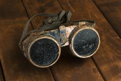Old rusty steampunk goggles - stock photo