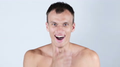 Portrait of topless young man receives a good news - stock footage