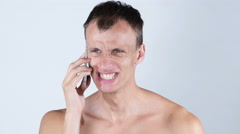 Portrait of  sad desperate angry man talking on  phone and yelling - stock footage