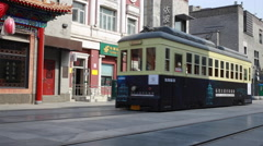 Chinese Tram on QianMen street, famous tourist place in Beijing, China Stock Footage