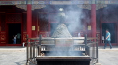 Smoking incense sticks in Lama temple, Beijing, China Stock Footage