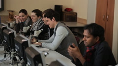 A group of students sitting in a row with microscopes in practical classes Stock Footage