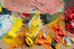 Closeup of paint mixing process in art workplace. - stock photo