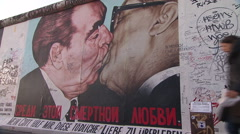 A painting of Brezhnev and Honecker on the wall between West from East Be - stock footage