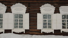 Russian carved wooden frames beautify exterior of timbered house Stock Footage