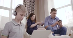 Family of three people uses gadgets and does not communicate. Сoncept of Stock Footage