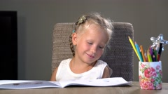 Four-year girl performs educational tasks Stock Footage