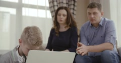 Parents are very unhappy that the son spends much time at the computer. Сoncept Stock Footage