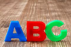 ABC spelling  of colorful plastic letters Stock Photos