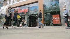 Oxford Street shoppers passing the Disney store, London, UK Stock Footage