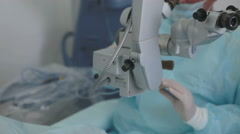 Close up hands in surgical gloves performing surgery using sterilized equipment Stock Footage