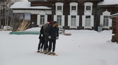 Group of people tries to move on one pair of wooden skiing Stock Footage