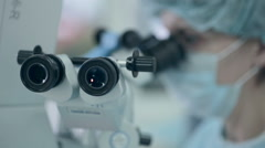 Unrecognizable Doctor looking in microscope during operation Stock Footage