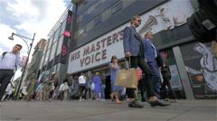 Oxford Street shoppers passing the HMV store, London, UK Arkistovideo