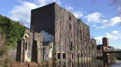 Derelict flour mill industrial architecture canal Stock Footage