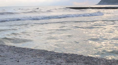 Woman walking on beach at sunset in summer. - stock footage