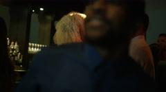 4K Party crowd dancing & having fun in nightclub, couple chatting & flirting Stock Footage