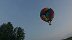 Hot air balloon takes off at dusk Stock Footage