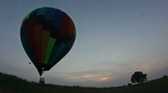 Hot air balloon takes off at sunset Stock Footage