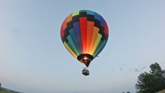 Hot air balloon landing at sunset Stock Footage