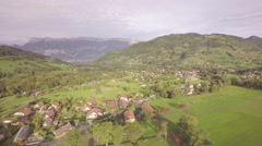 Aerial view of a village on the countryside in France - Isère Stock Footage