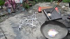 Thai people lead Ingots in pot local thai style - stock footage