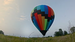Photographer photographing a couple near hot airballoon Stock Footage