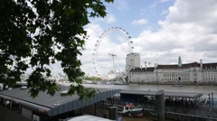 Millennium Wheel and a canopy of leaves in London - stock footage