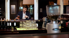 Young successful businessman drinking beer in cafe - stock footage
