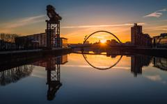 Sunrise at the Clyde Arc (Squinty Bridge), Pacific Quay, Glasgow, Scotland, - stock photo