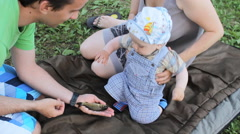 The little boy the first time touching a live fish. He takes her hand and Stock Footage