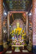 Main altar, interior of Wat Xieng Thong Buddhist temple, UNESCO World Heritage - stock photo