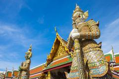 Yaksha Thotsakhirithon statue in front of Phra Ubosot, Temple of the Emerald Stock Photos