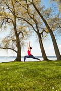 Side view of woman arms raised in yoga position - stock photo