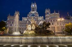 Fountain and Plaza de Cibeles Palace (Palacio de Comunicaciones) at dusk, Plaza Stock Photos
