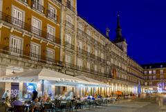 Plaza Mayor cafes at dusk, Madrid, Spain, Europe Stock Photos