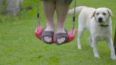 A white boy with his feet on the swing seat Stock Footage