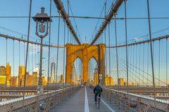 Manhattan, Brooklyn Bridge over East River, Lower Manhattan skyline, including Stock Photos