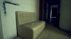 Old torn dirty couch on old ghetto building, hallway entrance - stock footage