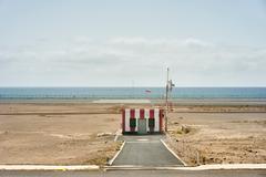 Coastal airport striped hut, Lanzarote, Spain - stock photo