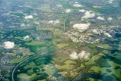 Aerial view of green fields and motorway, England, UK - stock photo