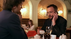 Business lunch. Two young successful businessmen discussing ideas in cafe. Slow Stock Footage