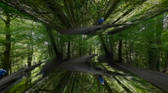 Distorted view of people walking in forrest - stock footage